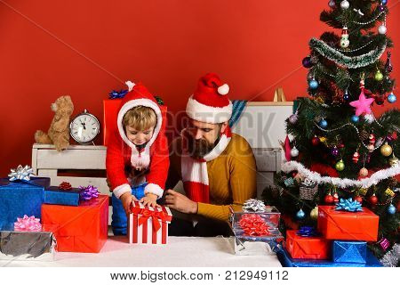 Man With Beard And Interested Face Play With Boy
