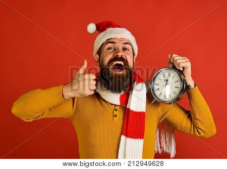 Santa Holds Old Clock Showing Thumbs Up. Winter Holiday Concept