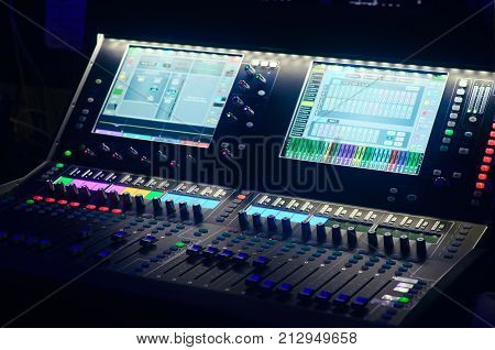 Board Mixing Console. Mixer. The Sound Engineer's Console. Sound Engineer's Fingers Are Pressing The
