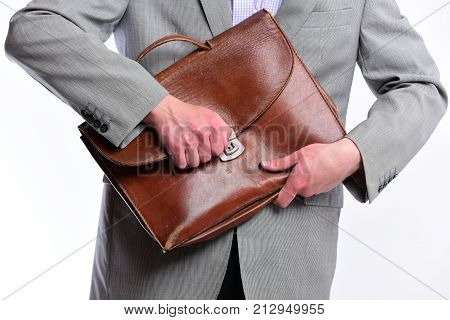 Male Hands Open Brown Leather Bag. Academic Style And Business