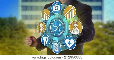 Unrecognizable healthcare administrator activating icons for higher quality care and lower expenses. Information technology concept for improvement of health care services and lowering of cost.