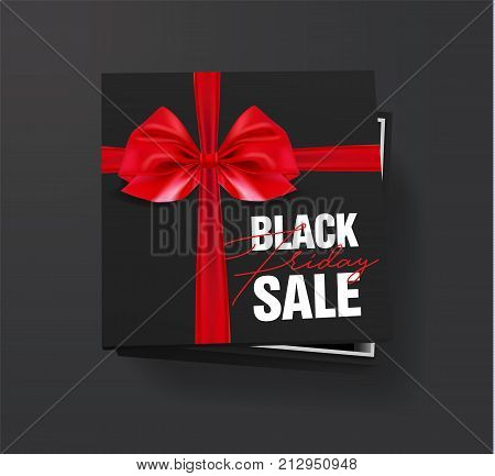 Black friday sale Black cardboard box tied with a red ribbon with a bow is lying on a black background with the inscription Black friday Top view Template for the poster, banner and web