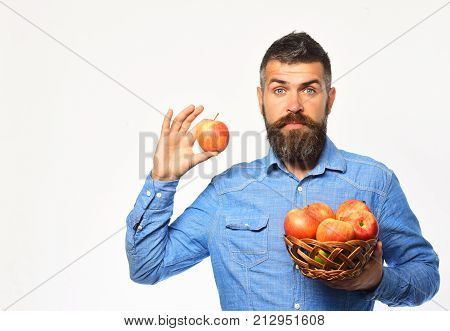 Farmer With Surprised Face Holds Red Apples