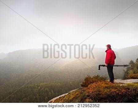 Nature Photographer Prepare Camera To Takes Impressive Photos Of Misty Fall Mountains. Tourist Photo