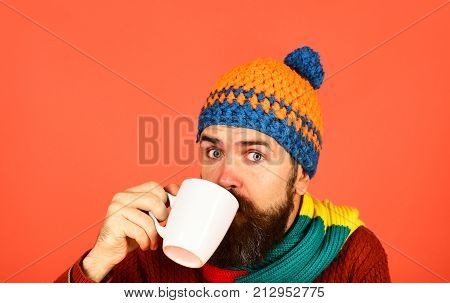 Caffeinated Or Decaf Beverages Idea. Man In Warm Hat