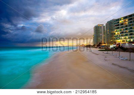 Cancun Forum beach sunset in Mexico at Hotel zone hotelera Playa Gaviota Azul
