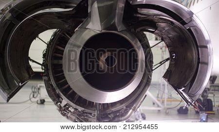 Engine of the airplane under heavy maintenance. Aircraft maintenance, dismantled plane engine.
