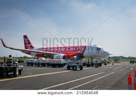 Semarang, Indonesia - October 2017: Air Asia Airbus landed at sunrise - Ahmad Yani International Airport, Semarng, Indonesia. Air Asia company is the largest low cost airlines in Asia.