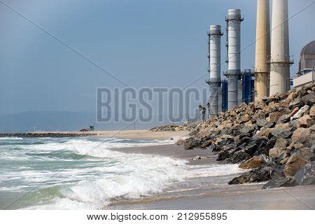 Smoke stacks of a power plant on the beach near El Segundo California