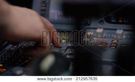 Autopilot control element of an airliner. Panel of switches on an aircraft flight deck. Thrust levers of a twin engined airliner. Pilot controls the aircraft. Onboard computer, cockpit 4K