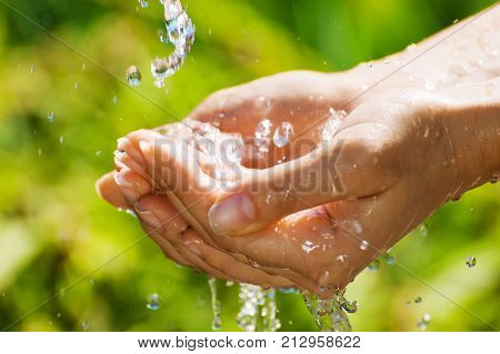 Woman Washing Hand Outdoors. Natural Drinking Water In The Palm. Young Hands With Water Splash, Sele
