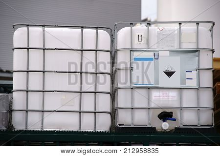 Large acid-proof plastic containers for transportation of corrosive and acidic chemicals.