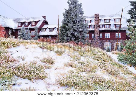 Historic Crater Lake Lodge built in 1915 surrounded by a pine forest and blanketed by snow taken in Crater Lake, OR