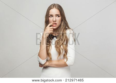 Hmm, Let's My Think. Confusion Beautiful Woman Touching Fingers Her Chin And Wondering