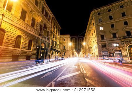 Rome road at night, urban traffic cars light trails and citylife. Italy. Corso Vittorio Emanuele II (street), in the old town.
