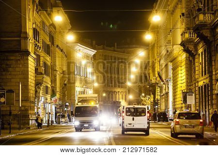 ROME, ITALY. February 18, 2015: Rome road at night, urban traffic and citylife. Italy. Corso Vittorio Emanuele II (street), in the old town.