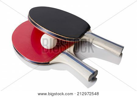 Red and Black Ping Pong Paddles and a ping pong ball sitting on white with reflection.