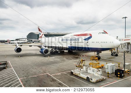 LONDON UK - CIRCA 2017: British Airways Boeing 747 airliner parks at a gate at Heathrow Airport Terminal 5
