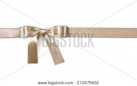 Golden ribbon with a bow isolated on a white background