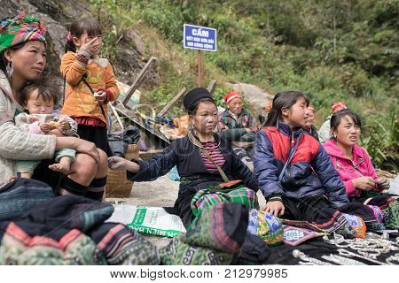 LAO CAI SAPA VIETNAM -NOV52017 : northern vietname hill tribe sitting beside road for selling hand made product in sapa town most popular traveling destination in northern of vietnam