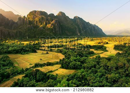 Aerial View Of Farm Fields And Rock Formations In Vang Vieng, Vientien Province, Laos