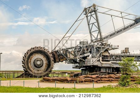 Industrial landscape and heavy equipment for oil sands industry huge digger