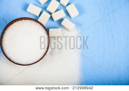Sugar In A Wooden Bowl And Cubes Of Sugar