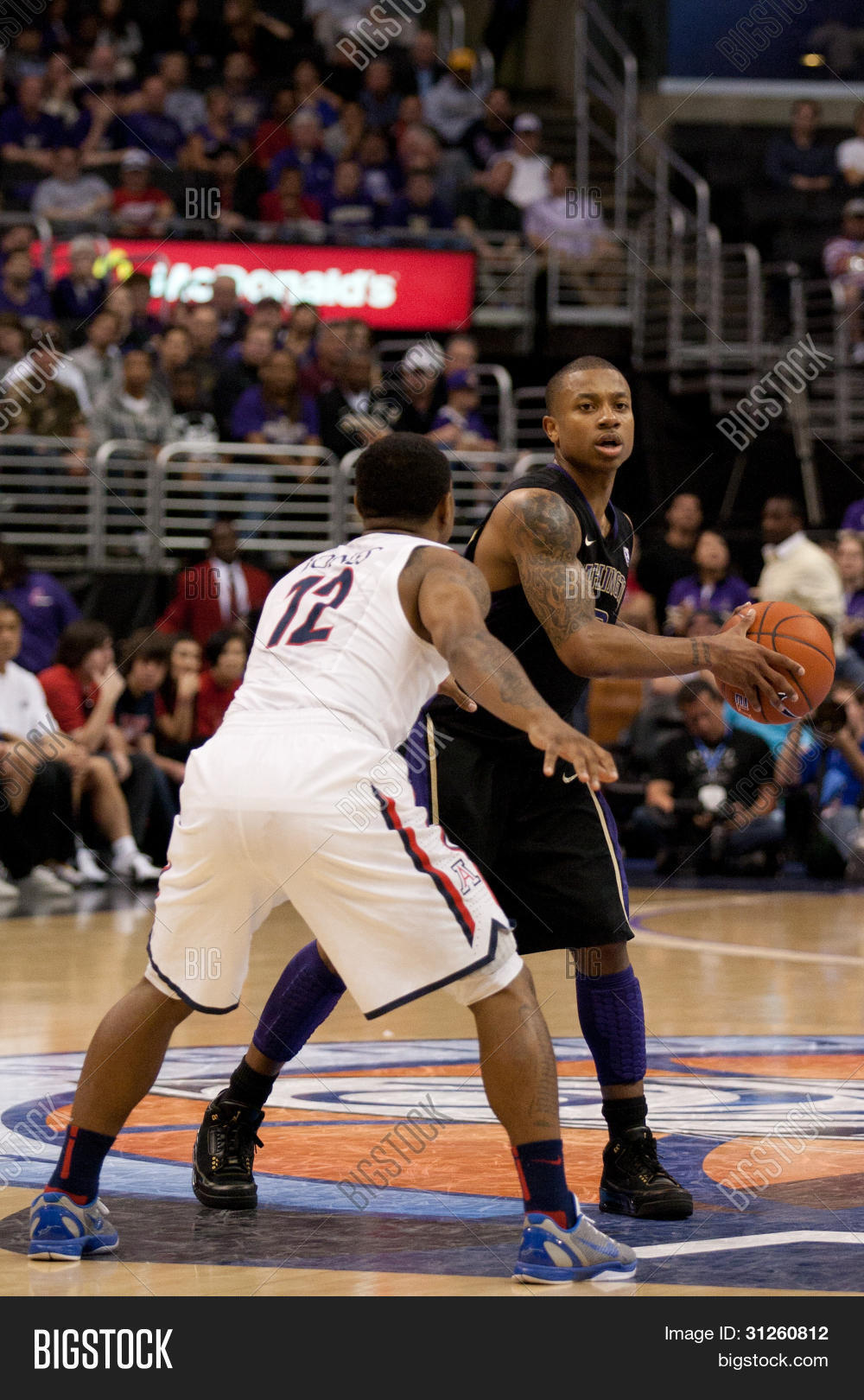 9d3e29c28754 LOS ANGELES - MARCH 12  Washington Huskies G Isaiah Thomas  2   Arizona  Wildcats G Lamont Jones  12 during the NCAA Pac-10 Tournament basketball ...