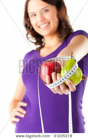 Healthy eating - woman with apple and pear and measuring tape on diet
