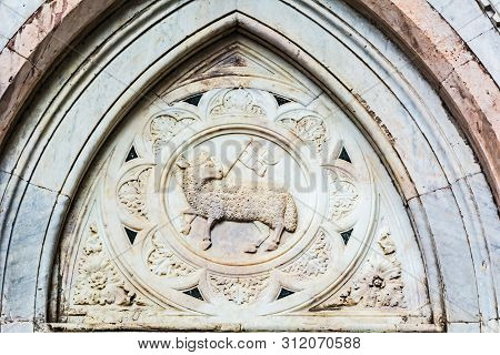 Florence, Italy - May 11, 2019: Bas-relief Of A Sheep With A Flag On Cattedrale Di Santa Maria Del F