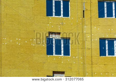 High-altitude Work On The External Walls Of Glass Wool Insulation And Plaster