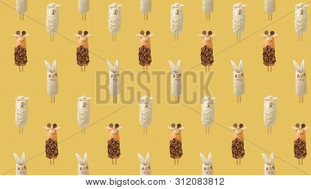Colorful Pattern Consisting Of Bananas In Chocolate In The Form Of Various Animals On Yellow Backgro