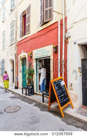Marseille, France - September 8th 2015: A Woman Walks Past A Small Restuarant,. The Old Port Area Ha