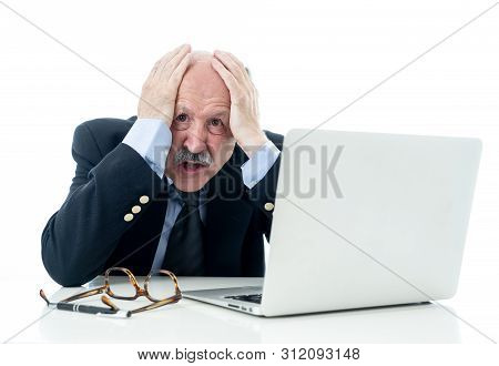 Overwhelmed And Tired Old Businessman Working With Laptop Feeling Angry At Office