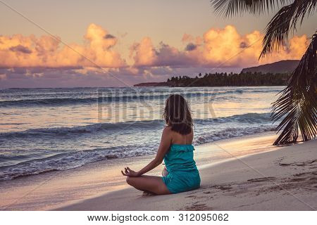 Woman Doing Yoga On Tropical Beach In Vacation. Young Woman Traveler Doing Yoga In Vacation. Travele
