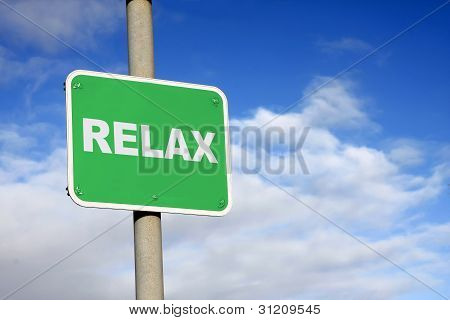Green relax sign against a blue sky poster