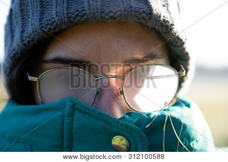 Closeup Of Girl With Foggy Glasses On Winter