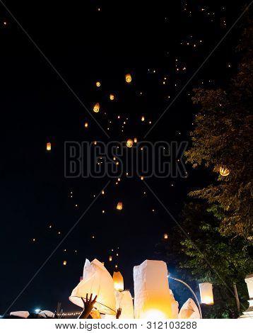 People Releasing Paper Lanterns During Loi Krathong And Yi Peng Festival