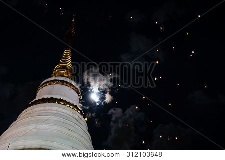 Loi Krathong And Yi Peng Released Paper Lanterns On Cloudy Sky And Moon And Temple
