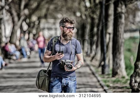 Photographer Hold Vintage Camera. Modern Blogger. Manual Settings. Photographer With Beard And Musta