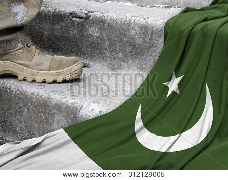 Military Concept On The Background Of The Flag Of Pakistan