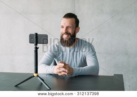 Modern Business Coaching. Confident Hipster Guy Using Smartphone Camera To Record Speech Video. Copy