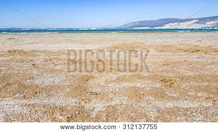 Empty Beach With Wet Salty Sands In Didim, Turkey
