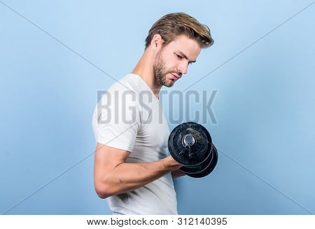 Handsome Guy Workout. Exercising At Gym. Muscular Man Exercising With Dumbbell. Sportsman Training S