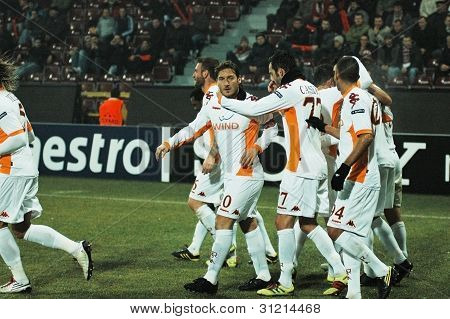 Soccer players of AS Roma celebrating a goal