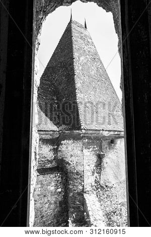 Black And White Partial View Of A Tower At The Corvin Castle, Hunyadi Castle Or Hunedoara Castle, Hu