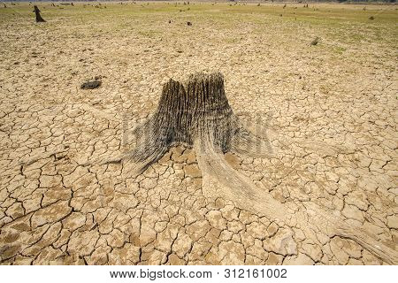 Dam At Parched, Dry Terrain, Drought, Climate Change And Drought Land
