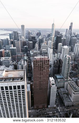 Chicago. Aerial View Of Chicago Downtown From High Above. Superimposed Cold Tone Filter. Vertical La