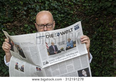 Frankfurt Am Main, Germany. June 29, 2019. A Man Reads The Die Welt  German Newspaper