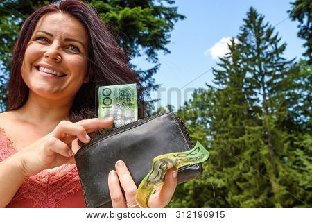 Australian Dollar. Woman Hand Holds Wallet And Australian Dollar Paper Money